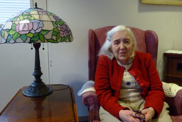 Mary Lou Spartz discussing aging issues in the parlor of Fireweed Place, , a seniors' apartment building in downtown Juneau. She among Southeast Alaska's growing older population. (Photo by Ed Schoenfeld/CoastAlaska News)