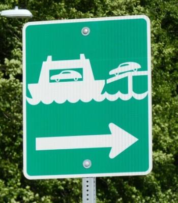 A sign along Juneau's Glacier Highway points to the Auke Bay Ferry Terminal (Photo by Ed Schoenfeld/CoastAlaska News)