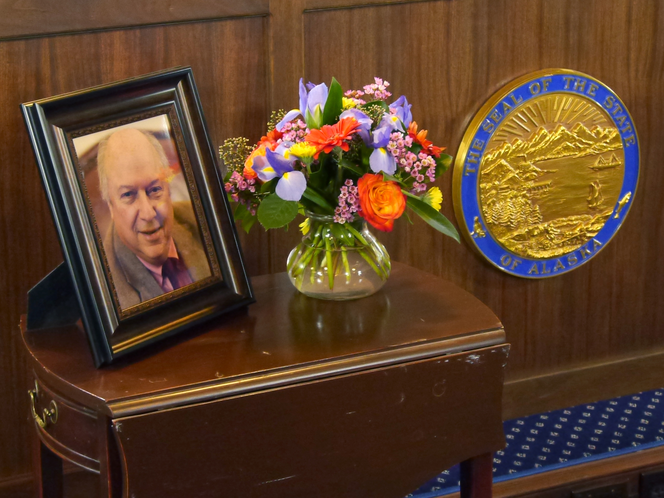 Photo of Rep. Max Gruenberg and state seal