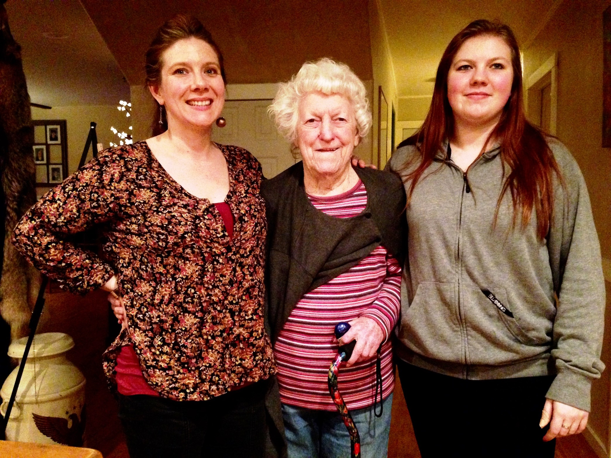 Elizabeth Tyner, 92, lives with her granddaughter, Melinda Cook, left, and great-granddaughter, Shawnee Cook, right. Tyner is among Southeast seniors aging at home. (Photo by Angela Denning/KFSK)