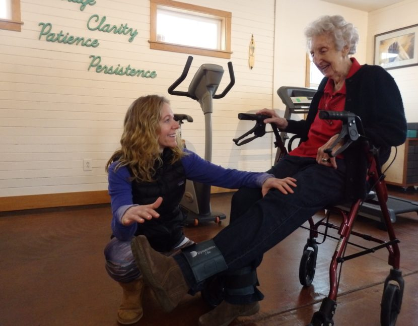 Haines physical therapist Marnie Hartman works with 92-year-old patient Marge Ward. Hartman says most of her business comes from people 65 and older. (Photo by Emily Files/KHNS)