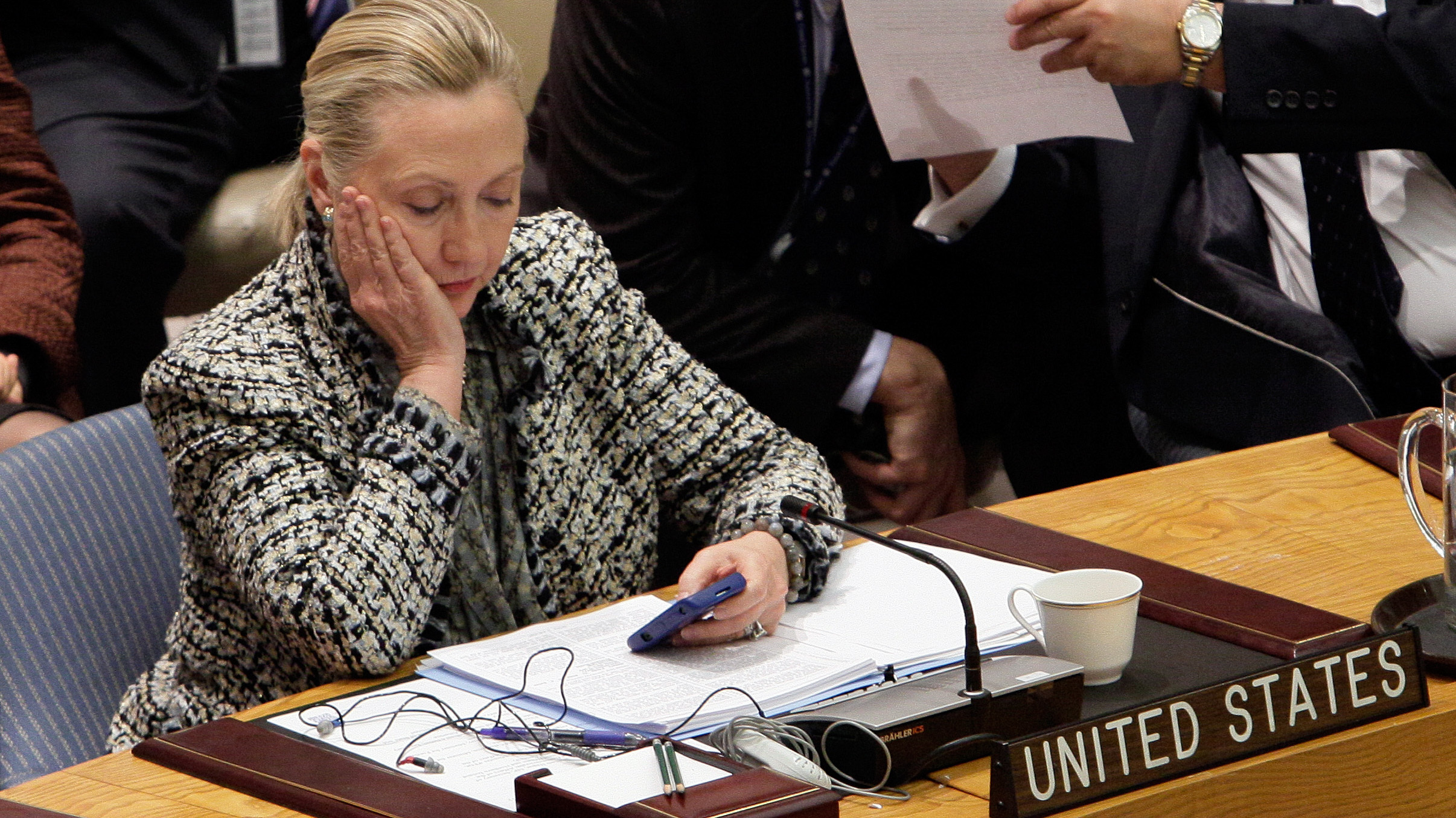 Hillary Clinton, then secretary of state, checks her cellphone after her address at a United Nations meeting in 2012. (Richard Drew/AP)
