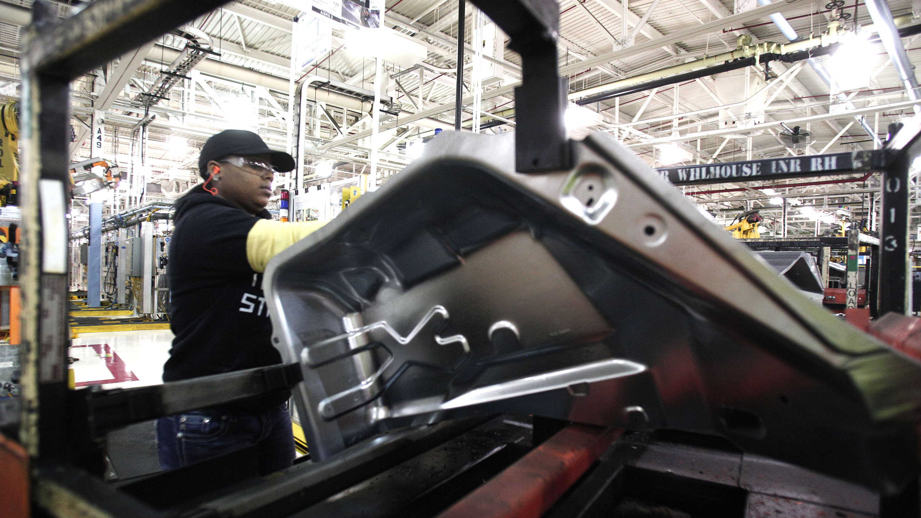 A worker is shown last month at the Fiat Chrysler Automobiles Warren Stamping Plant in Warren, Mich. (Bill Pugliano/Getty Images)