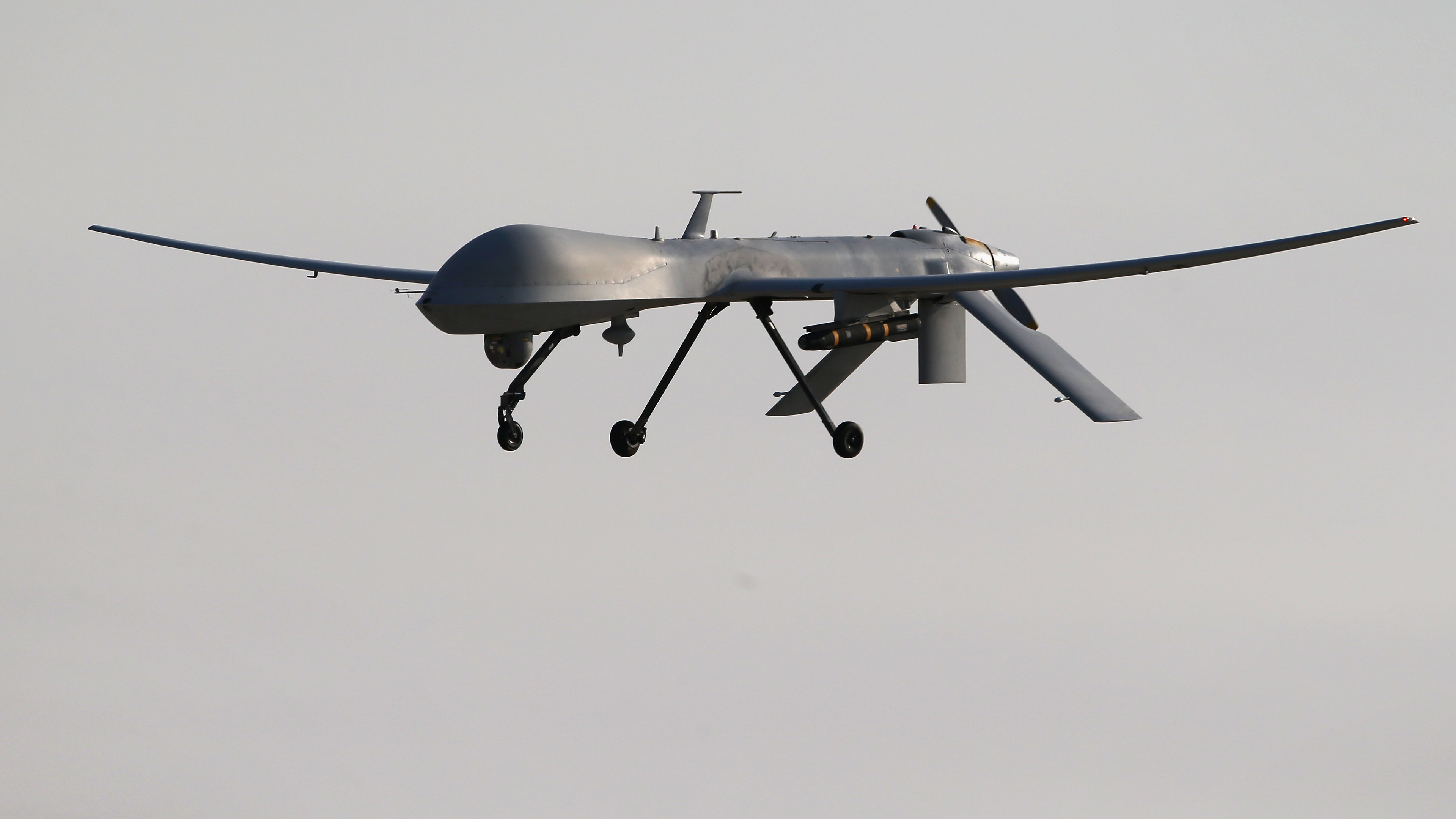 A U.S. Air Force MQ-1B Predator unmanned aerial vehicle, carrying a Hellfire missile, lands at a secret air base after flying a mission in the Persian Gulf region on Jan. 7. John Moore/Getty Images