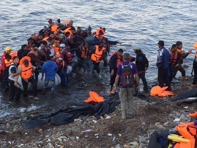 A raft filled with refugees on the shores of Lesbos. (Photo by Eric Kocher)