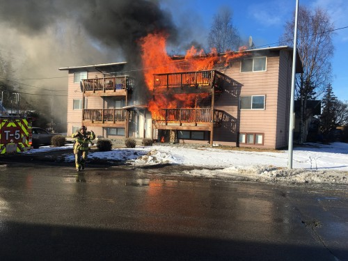 Sitka basketball players helped 11 occupants of this Anchorage six-plex escape the blaze. (Photo by Andy Lee)
