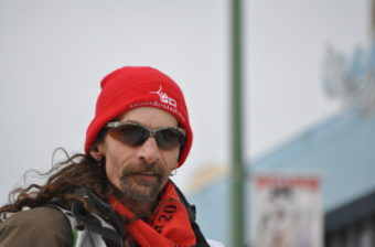 """Lance Mackey at the Anchorage Ceremonial Start. In Rainy Pass, Mackey reported """"a couple of dogs with sore wrists for no apparent reasons. (Photo by Zachariah Hughes/KSKA)"""