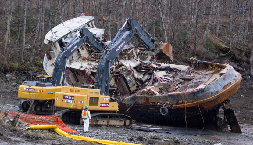 Excavators demolish the tug Challenger on March 7, 2016 (Photo by Mikko Wilson/KTOO)