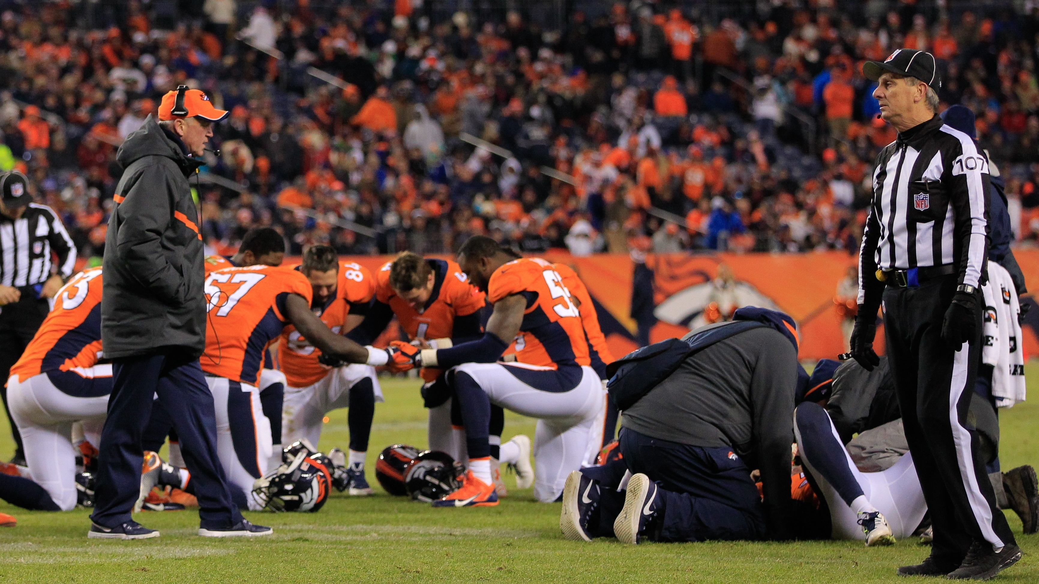 Before Monday, no NFL official had publicly acknowledged a link between football and chronic traumatic encephalopathy. Here, members of the Denver Broncos are seen after one of their teammates suffered a concussion during a game in late 2014. Doug Pensinger/Getty Images
