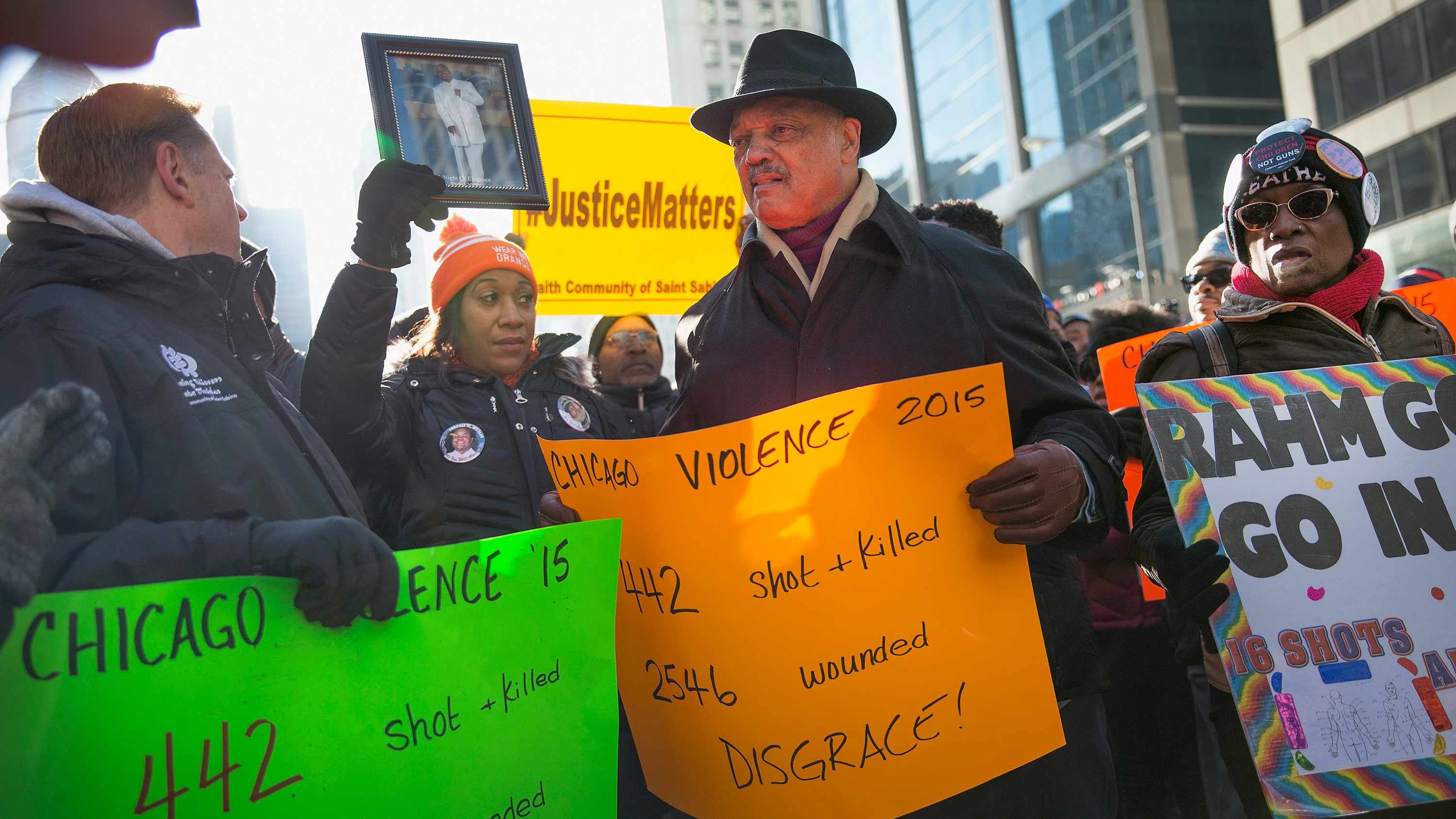 Demonstrators in Chicago call for an end to gun violence and resignation of Chicago Mayor Rahm Emanuel. Chicago police are under scrutiny following the release of a video showing the shooting of 17-year-old Laquan McDonald by a Chicago police officer. Scott Olson/Getty Images