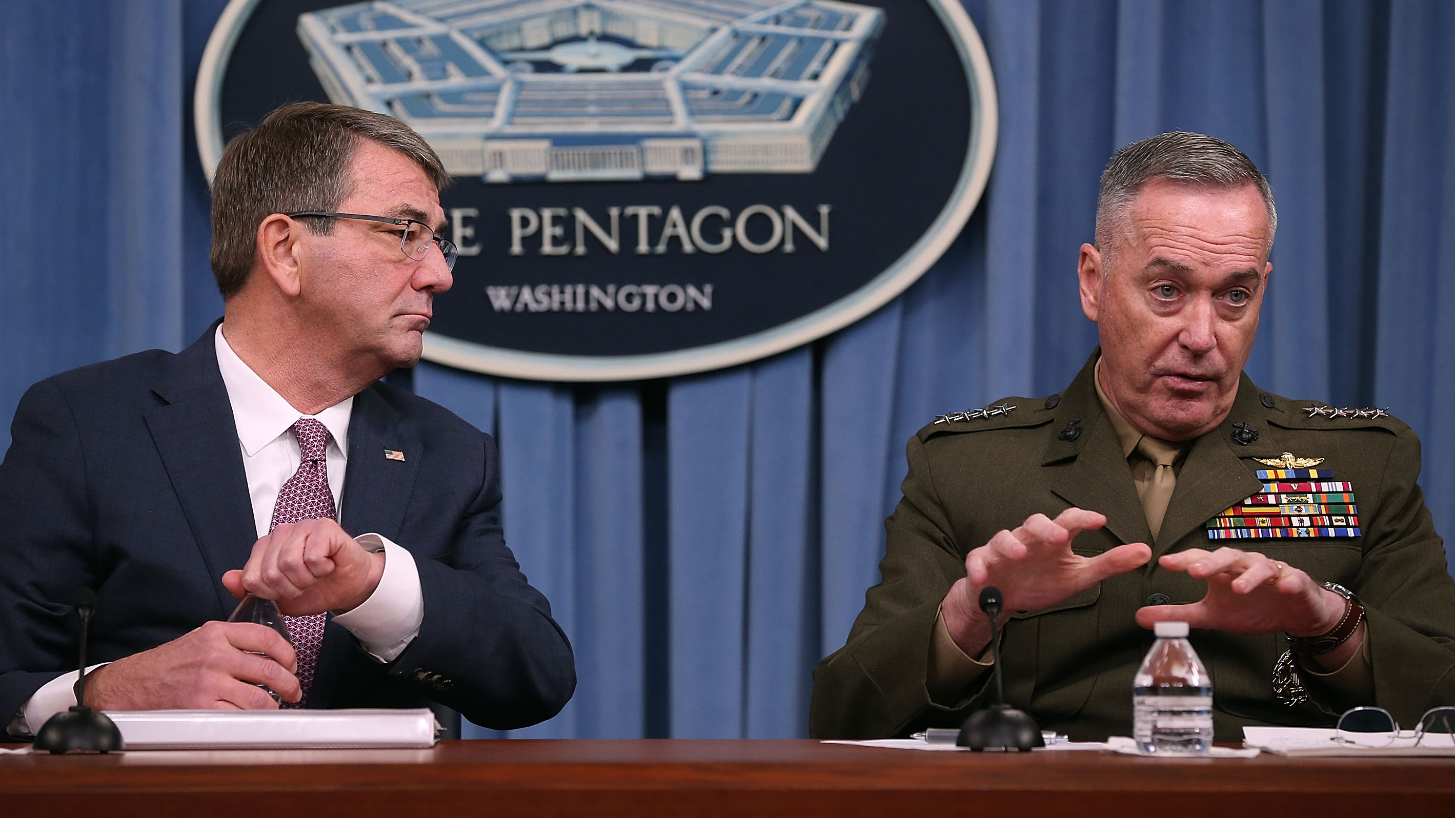 Secretary of Defense Ash Carter (left) says the Pentagon's new hacker program will strengthen America's digital defenses. Carter is seen here with the chairman of the Joint Chiefs of Staff, Gen. Joseph Dunford. Mark Wilson/Getty Images