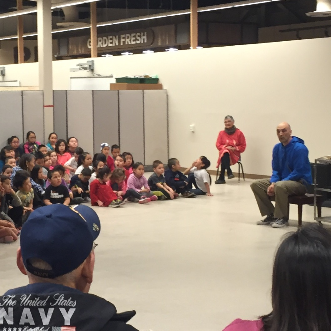 Principal Sam Crow addresses students and their families at the grand opening ceremony at Kipusvik. (Photo by Charles Enoch/KYUK)