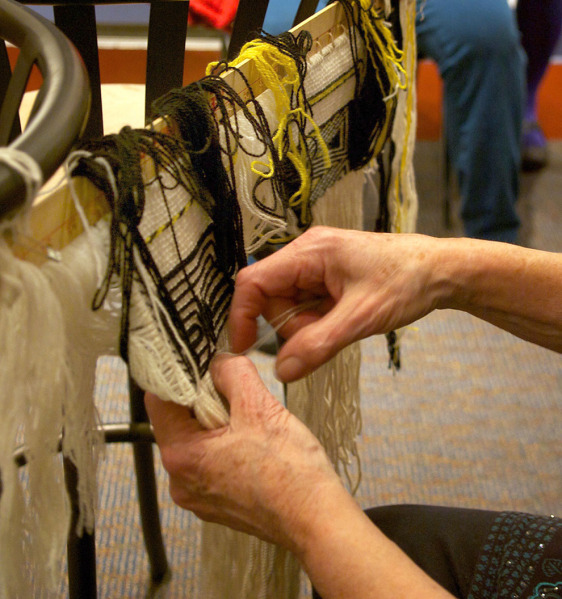 Ravenstail involves several intricate and complex weaving techniques, which Parker displayed for an eager crowd of local fiber artists. (Photo by Jenny Neyman/KDLL)