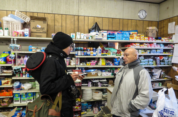Brian Adams interviews Karl Ashenfelter at the White Mountain Native Store. (Photo by Laura Kraegel/KNOM)