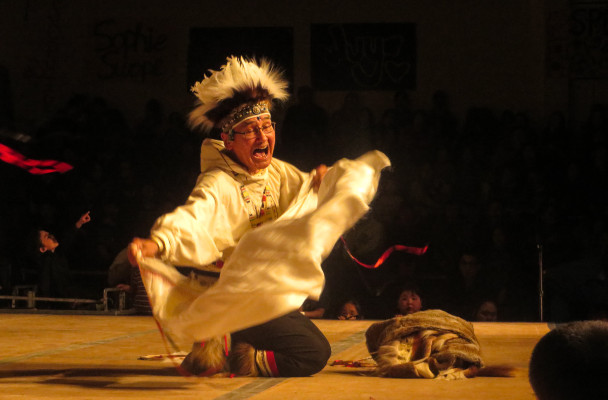 One performer leads the Nunamta Yup'ik Singers and Dancers at the 2016 Cama-i Dance Festival in Bethel. (Photo by Laura Kraegel/KNOM)
