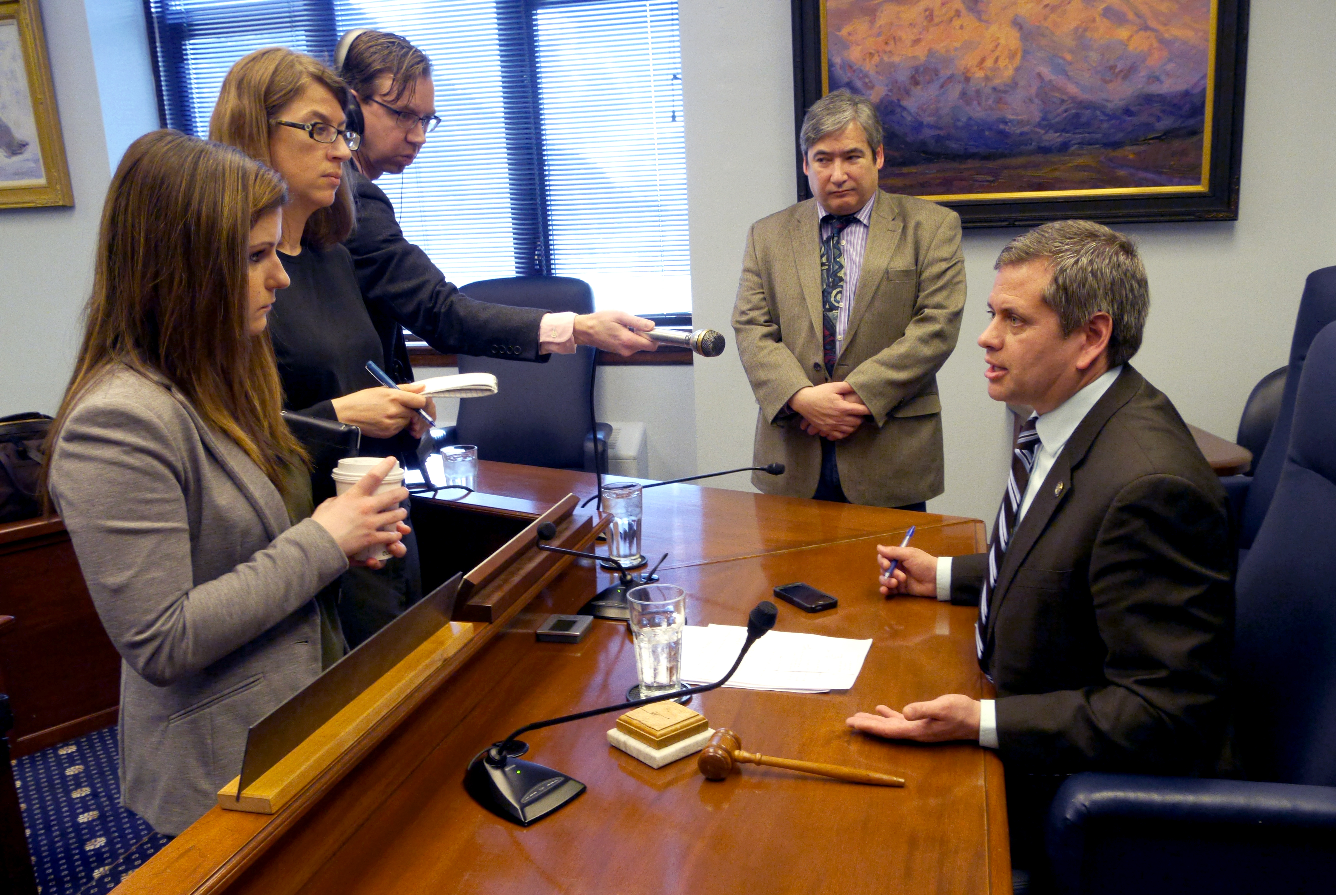 Rep. Chris Tuck, D-Anchorage, takes questions from reporters April 19, 2016. Rep. Sam Kito III, D-Juneau, stands to his right. Reporters, front to back, are Liz Raines of KTVA, Becky Bohrer of the Associated Press and Andrew Kitchenman of Alaska Public Media and KTOO. (Photo by Skip Gray/360 North)