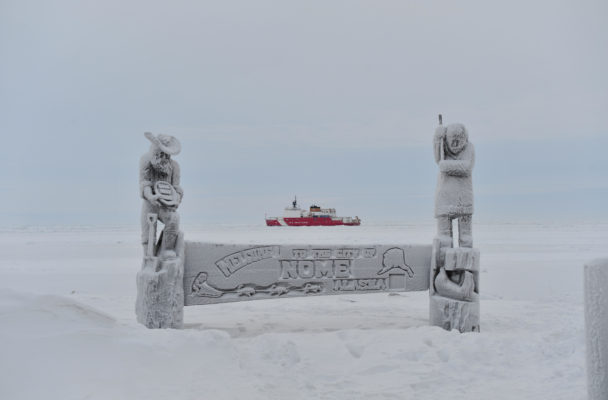 The Coast Guard Cutter Healy breaks ice near the city of Nome. (Public Domain photo by Chief Petty Officer Kip Wadlow/U.S. Coast Guard)