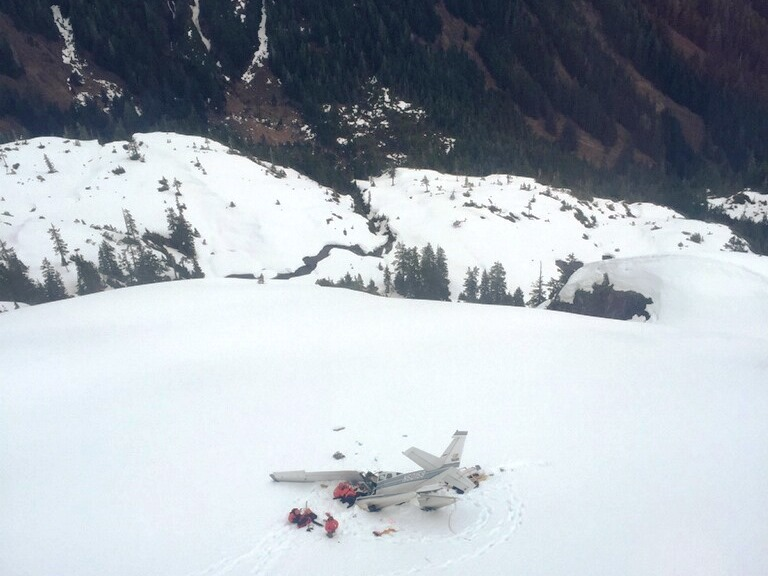 Rescuers work at the site of a crashed small plane on Admiralty Island on April 8. (Photo courtesy Sitka Mountain Rescue)