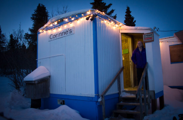 Corinne Trish outside her shop in Koyuk. (Photo by Emily Russell/KNOM)