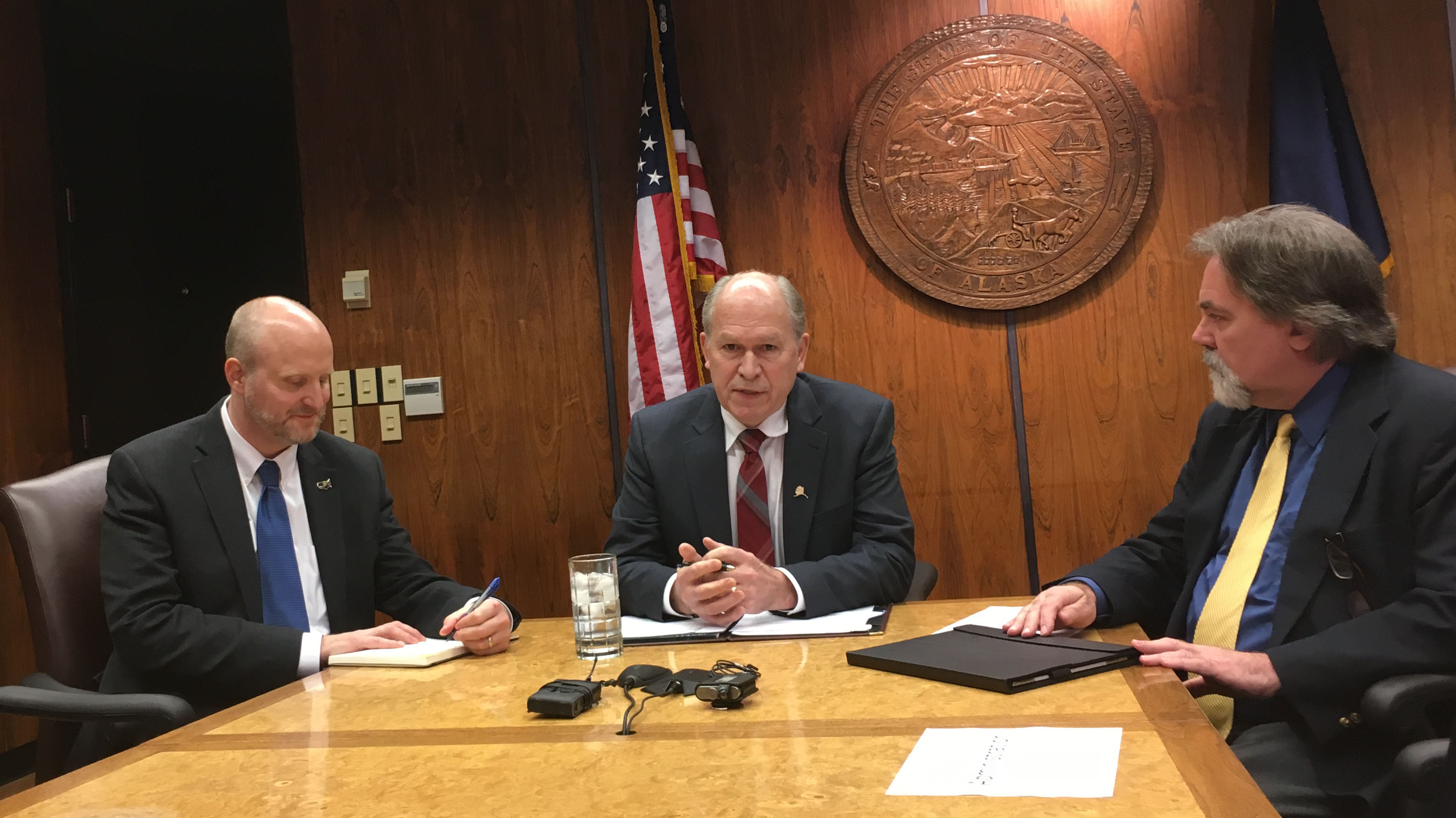 Gov. Bill Walker, flanked by Tax Division Director Ken Alper and Revenue Commissioner Randall Hoffbeck. Walker discussed oil and gas tax credits. (Photo by Andrew Kitchenman/KTOO)