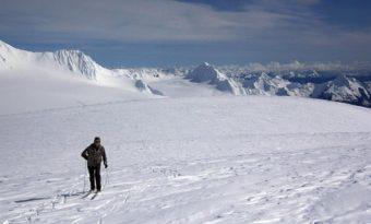 Chris Hanna on the Harding Icefield Friday, April 8th with Kenai Fjords National Park in the background, looking towards Seward. (Photo courtesy of Jenny Neyman)