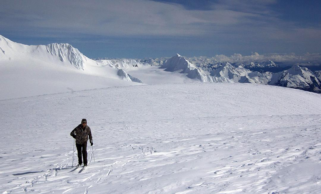 Chris Hanna on the Harding Icefield Friday, April 8th with Kenai Fjords National Park in the background, looking towards Seward. (Photo courtesy of Jenny Neyman)