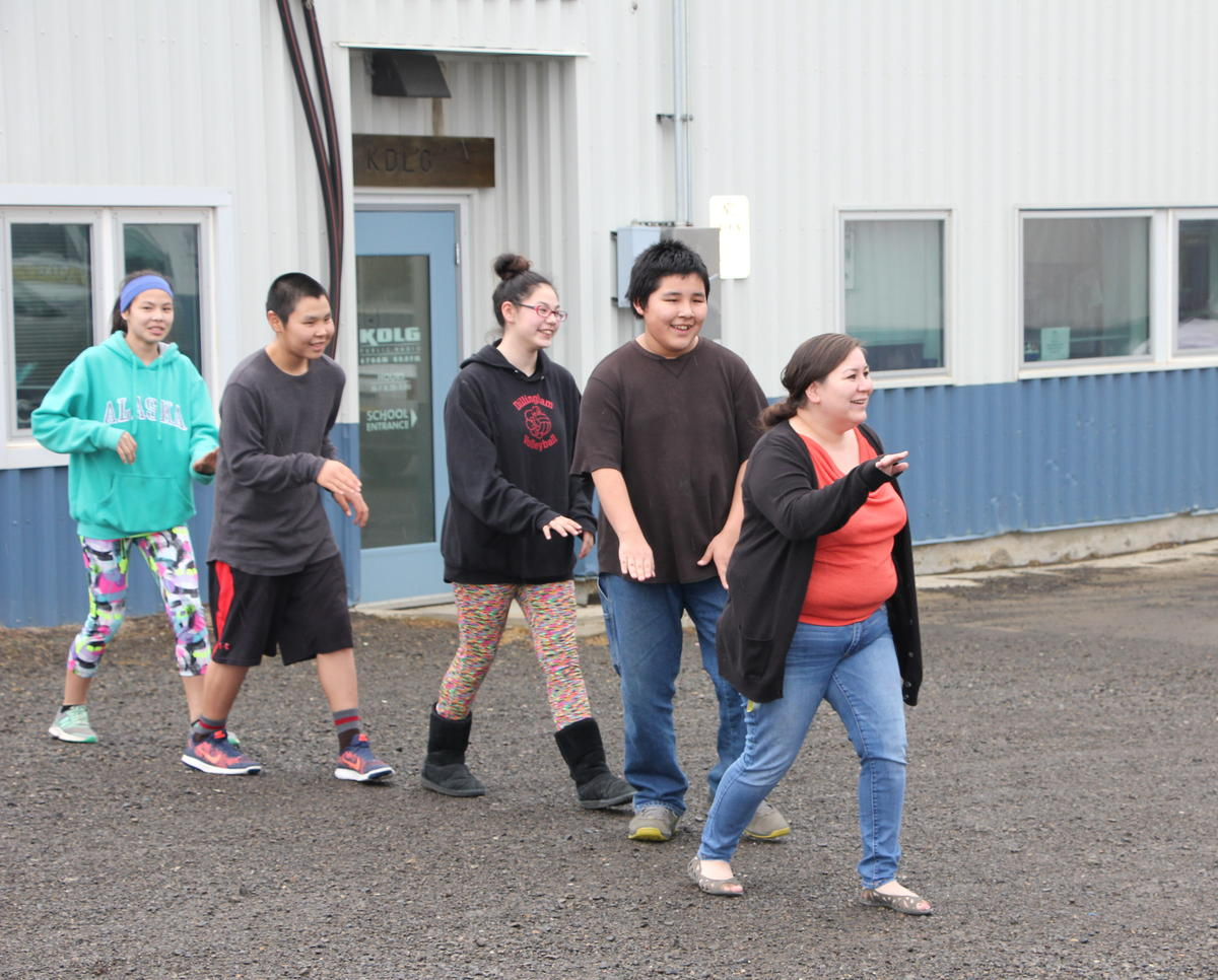 Dillingham students dance on a drizzly afternoon to take a break from their classroom. That would count toward a new physical activity standard for kindergarten through eighth graders that was proposed by lawmakers, but counting it up could be tricky. (Photo by Molly Dischner/KDLG)