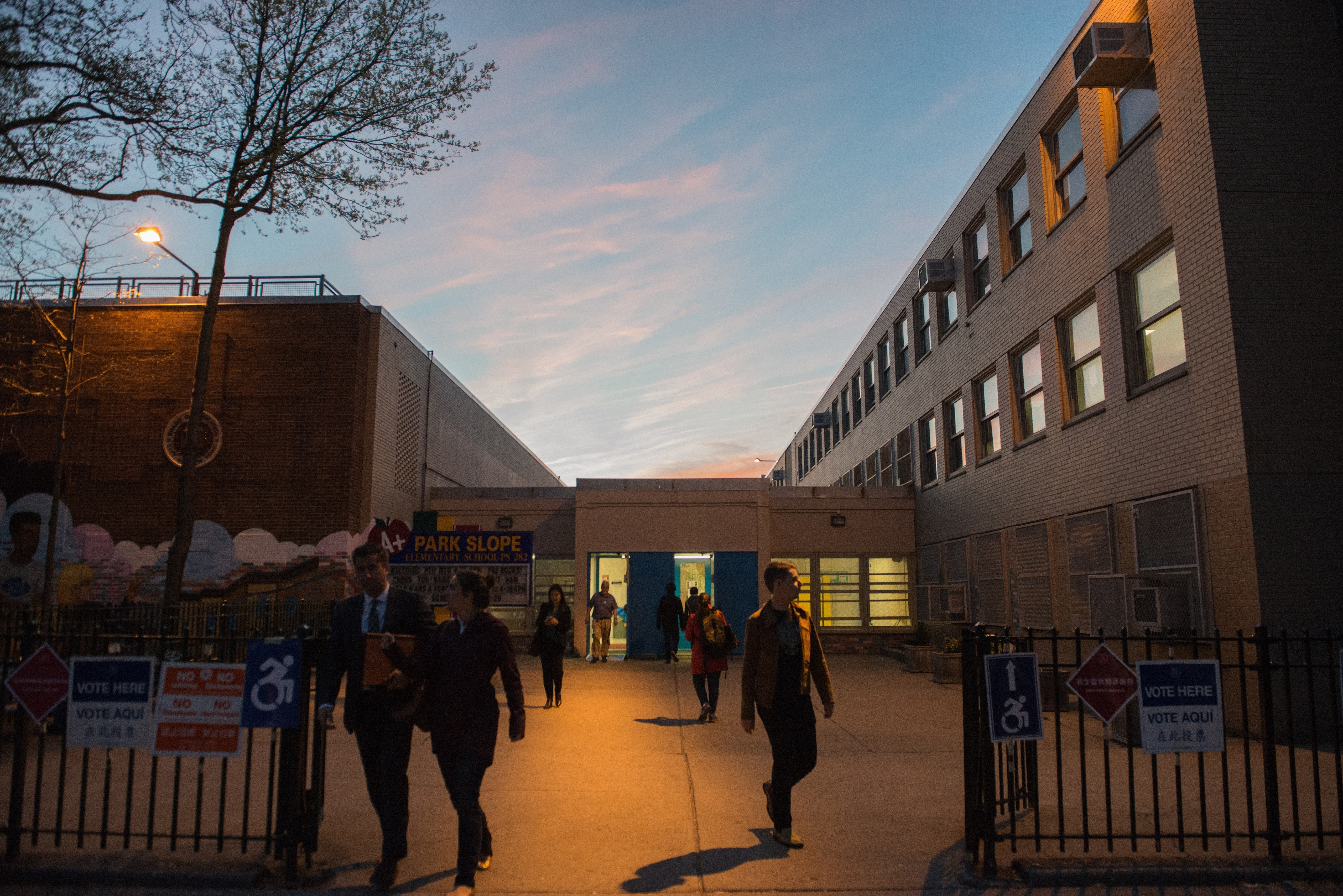 People exit the building after voting at P.S. 282 in Brooklyn on Tuesday. Stephanie Keith /Getty Images