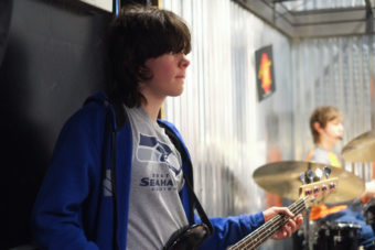 William Smoker, 14, plays the bass at Alaska Music One. (Photo by Annie Bartholomew/KTOO)