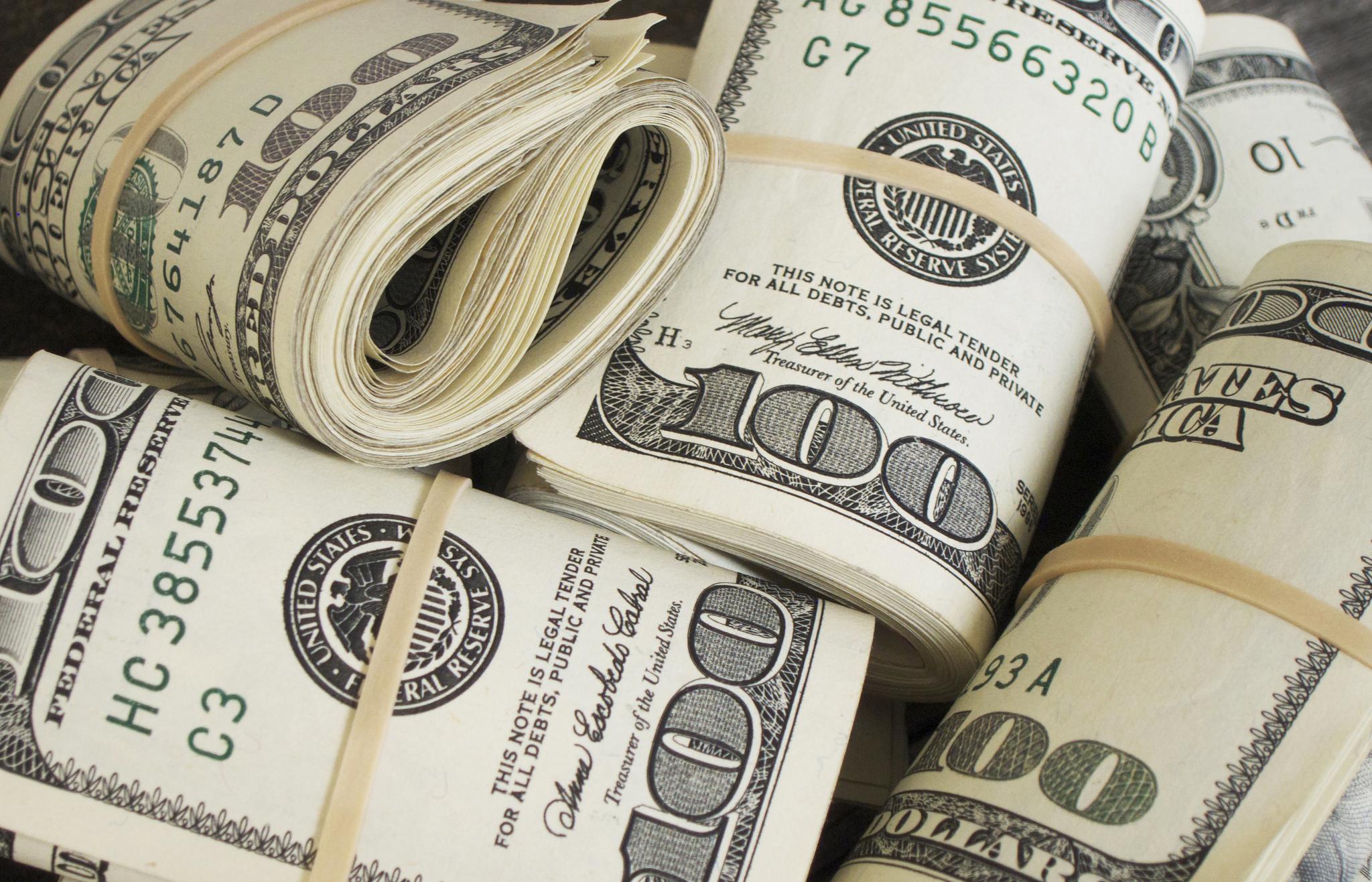 bundles of money cash