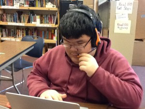 Rocky Mountain School seventh-grader Alexie Evan using the HMH Read180 program. (Photo by Sherri Carmichael.)