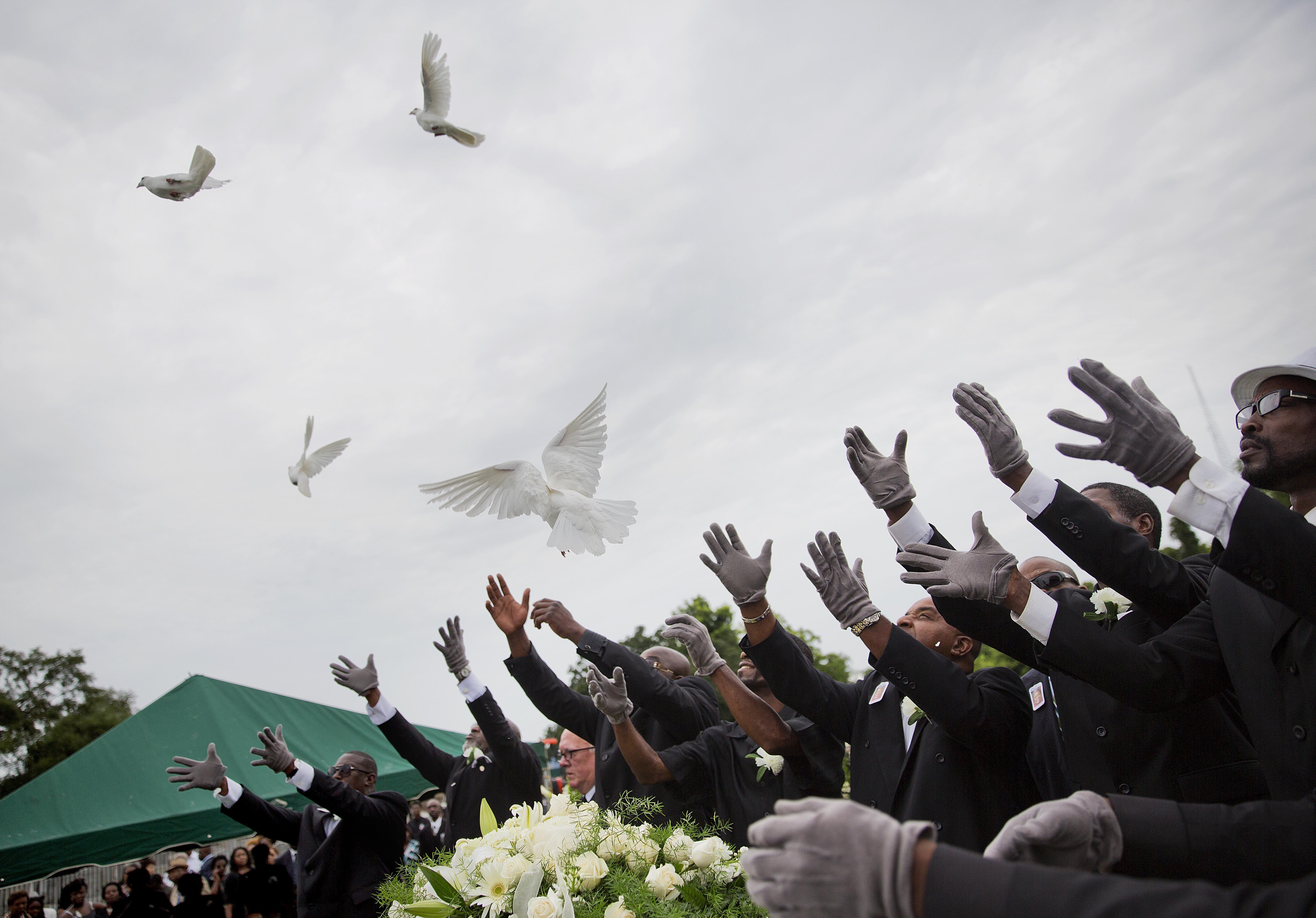 Pallbearers doves Ethel Lance coffin Charleston shooting
