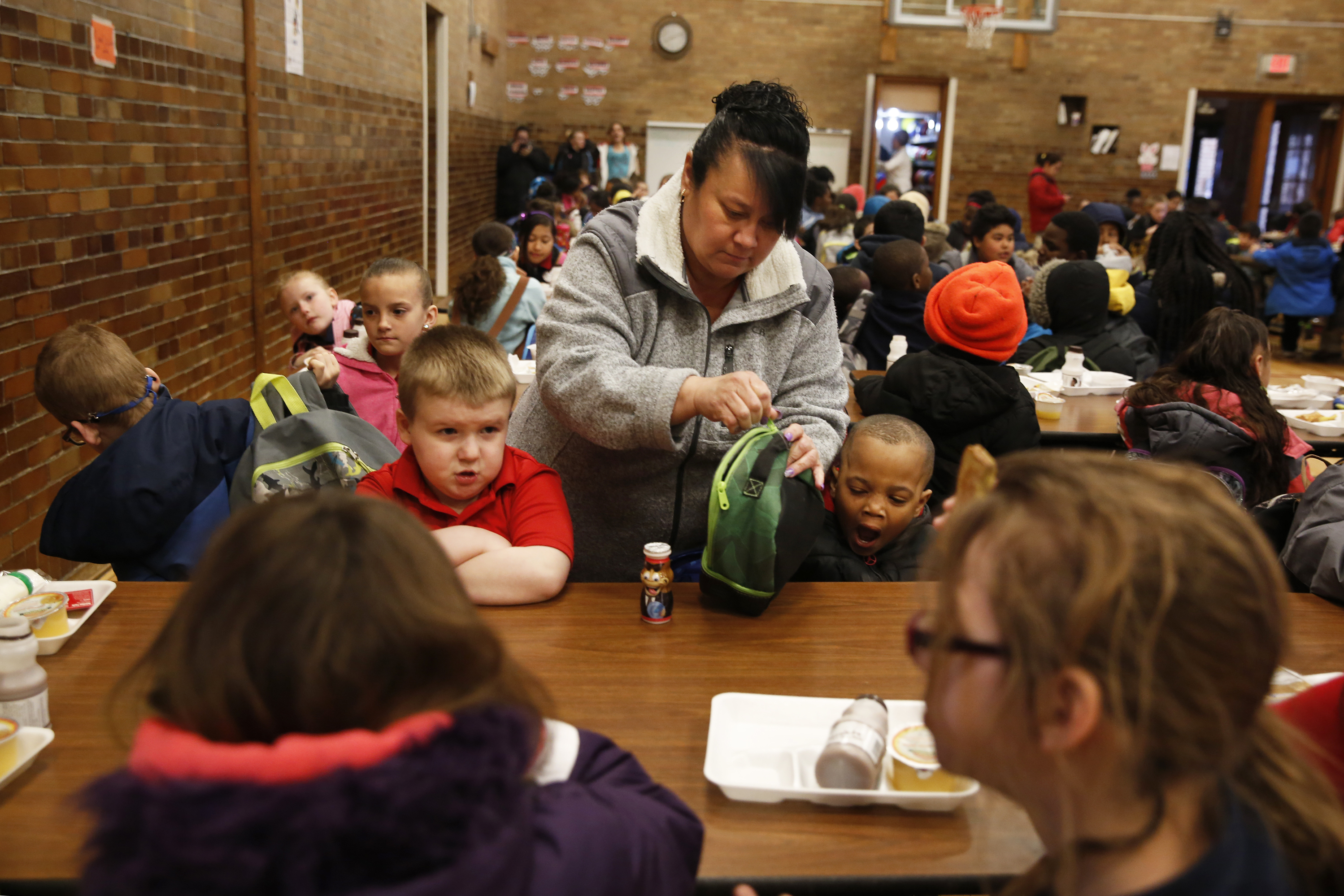 Cyndy Bulson now volunteers at Stocking, helping monitor kids in the morning, serving breakfast and chaperoning field trips. (Photo by Elissa Nadworny/NPR)