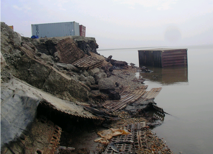 A steel storage container slid into the water after erosion chewed away at this bank in Newtok.
