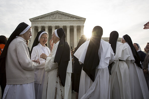 Nuns opposed to the Affordable Care Act's contraceptive mandate rally outside the Supreme Court on March 23 prior to oral arguments in Zubik v. Burwell. The Supreme Court sent the case back to a lower court on Monday. Drew Angerer/Bloomberg/Getty Images