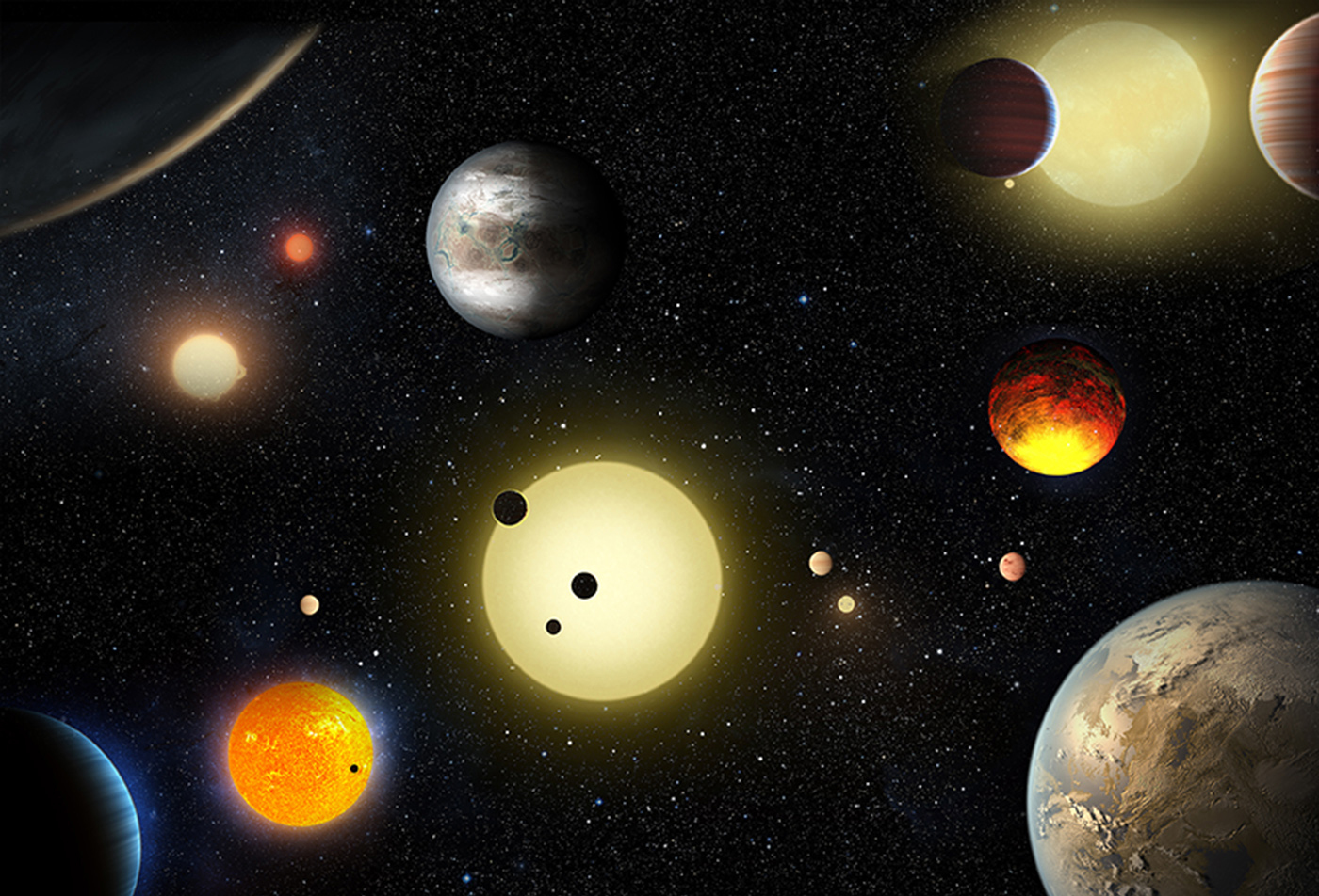 This artist's concept depicts some of the planetary discoveries made by NASA's Kepler Space Telescope. Tuesday's announcement more than doubles the number of verified planets discovered by the Kepler mission. W. Stenzel/NASA