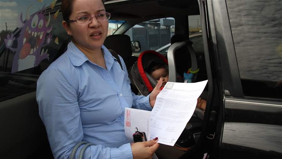 A woman shows a letter she received from health authorities saying her son was exposed to tuberculosis in a hospital in El Paso, Texas. State and local health departments are the front line of defense against a disease that may be on the upswing. AP