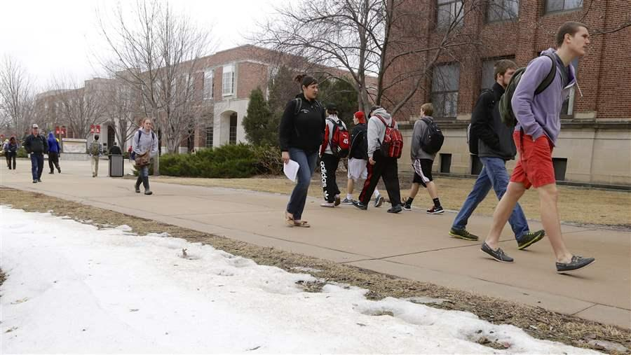 Students cross the University of Nebraska campus. A new Nebraska law requires colleges to send students estimates of their cumulative student loan debt. (Photo courtesy of Pew Charitable Trusts)