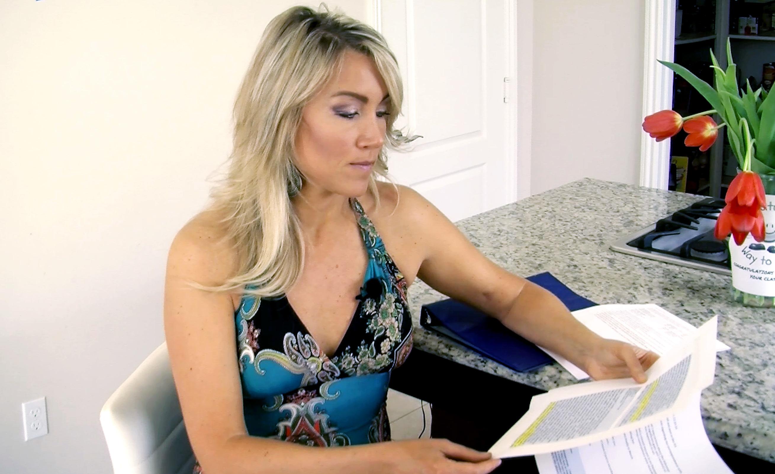Navy veteran Amanda Wirtz looks through her correspondence with the Veterans Choice program. After the VA couldn't get her an appointment with a specialist, it sent her to the Choice program. But she still was unable to get an appointment for several months. Courtesy of KPBS