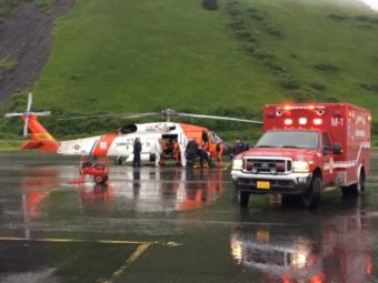 The U.S. Coast Guard and emergency medical personnel transfer patients from a MH-60 Jayhawk helicopter to an ambulance in Kodiak, Alaska, June 2, 2016. The helicopter crew responded to a report of a fire at the Park's Cannery near Uyak Bay on Kodiak Island. (Public Domain photo by U.S. Coast Guard)