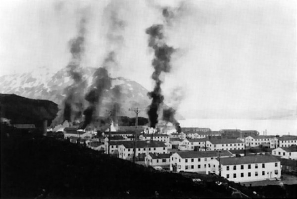 Buildings burning after the first Japanese attack on Dutch Harbor, Alaska (USA), 3 June 1942. (Public Domain photo by U.S. Army)