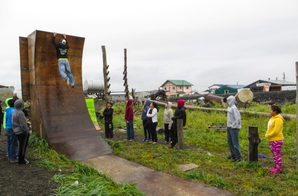 In November, Nick Hanson scales the Warped Wall at his 'American Ninja Warrior' obstacle course in Unalakleet. (Photo Laura Kraegel/KNOM)