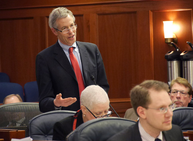 Rep. Matt Claman, D-Anchorage, discusses the state operating budget on the floor the House of Representatives, March 11, 2016. (Photo by Skip Gray/360 North)