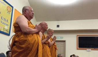 Three new monks wait for questions during the first official Buddhist monk ordination in Alaska. (Photo by Anne Hillman/KSKA)