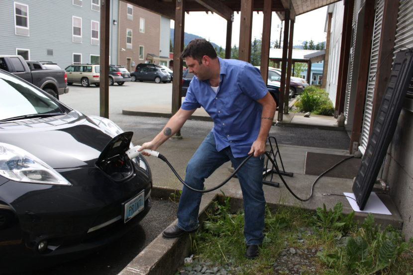Travis McCain plugs in his 2013 Nissan Leaf. (Photo by Elizabeth Jenkins/KTOO)