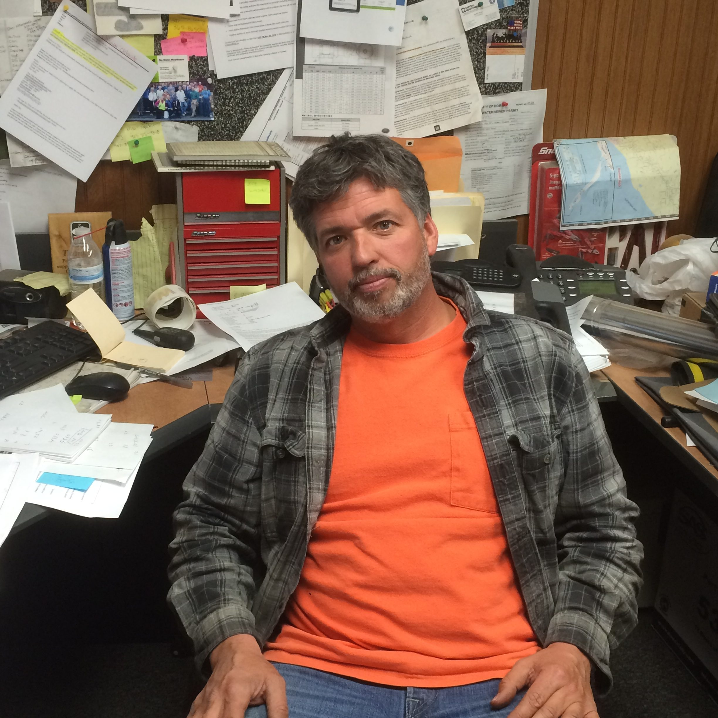 Lloyd Moore sitting inside his office at Moore and Moore Services in Homer. (Photo by Quinton Chandler/KTOO)