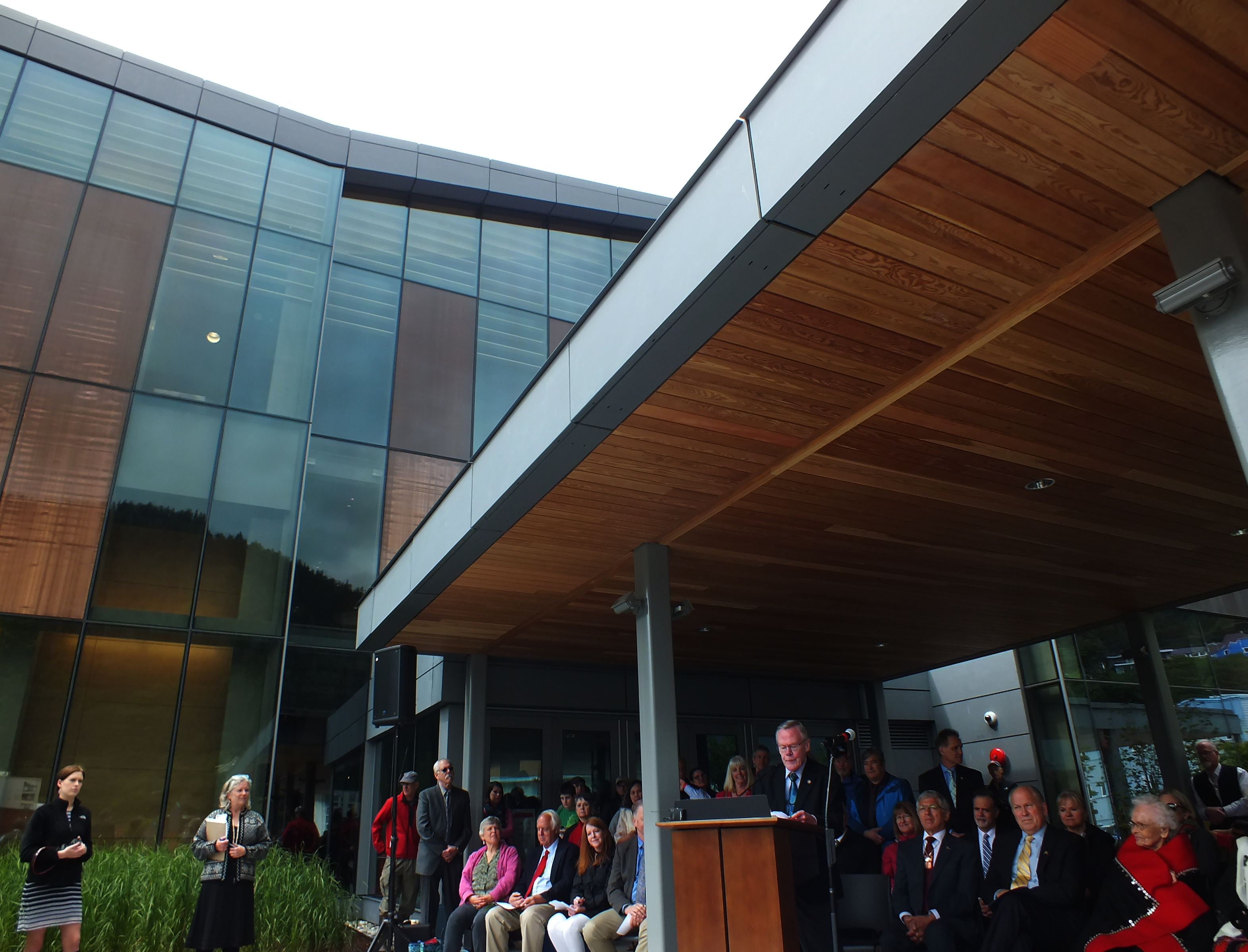 Juneau Sen. Dennis Egan addresses a crowd during grand opening of the Father Andrew P. Kashevaroff Library, Archives and Museum Building on June 6, 2016.