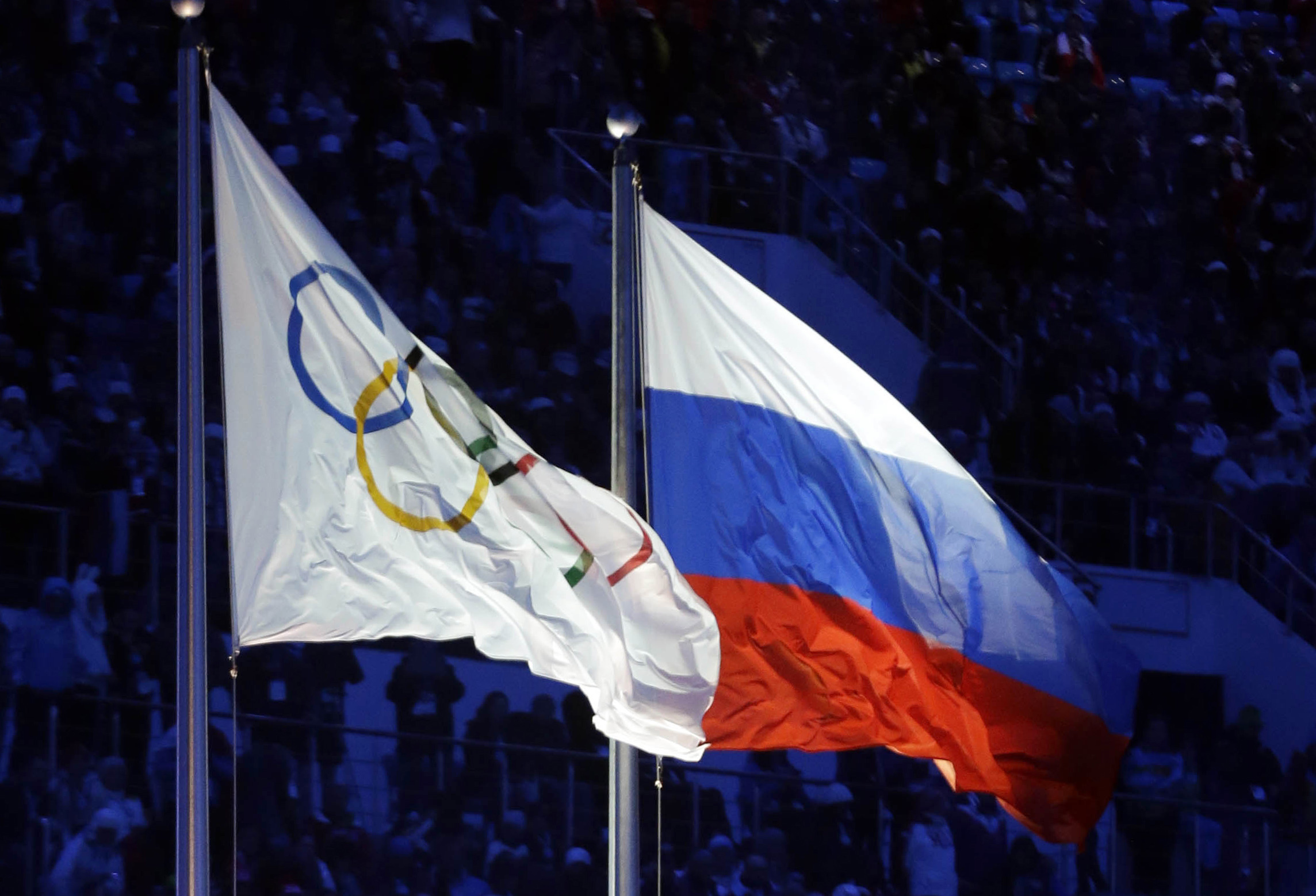 The Russian and the Olympic flags wave during the opening ceremony of the 2014 Winter Olympics in Sochi, Russia. Patrick Semansky/AP