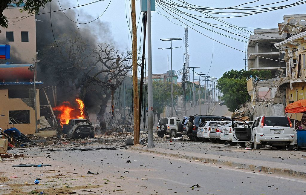 Fire is seen at the scene of a car bomb attack claimed by Al-Qaeda-affiliated Shabab militants on the Naasa Hablod hotel in Mogadishu on Saturday. Mohamed Abdiwahab /AFP/Getty Images