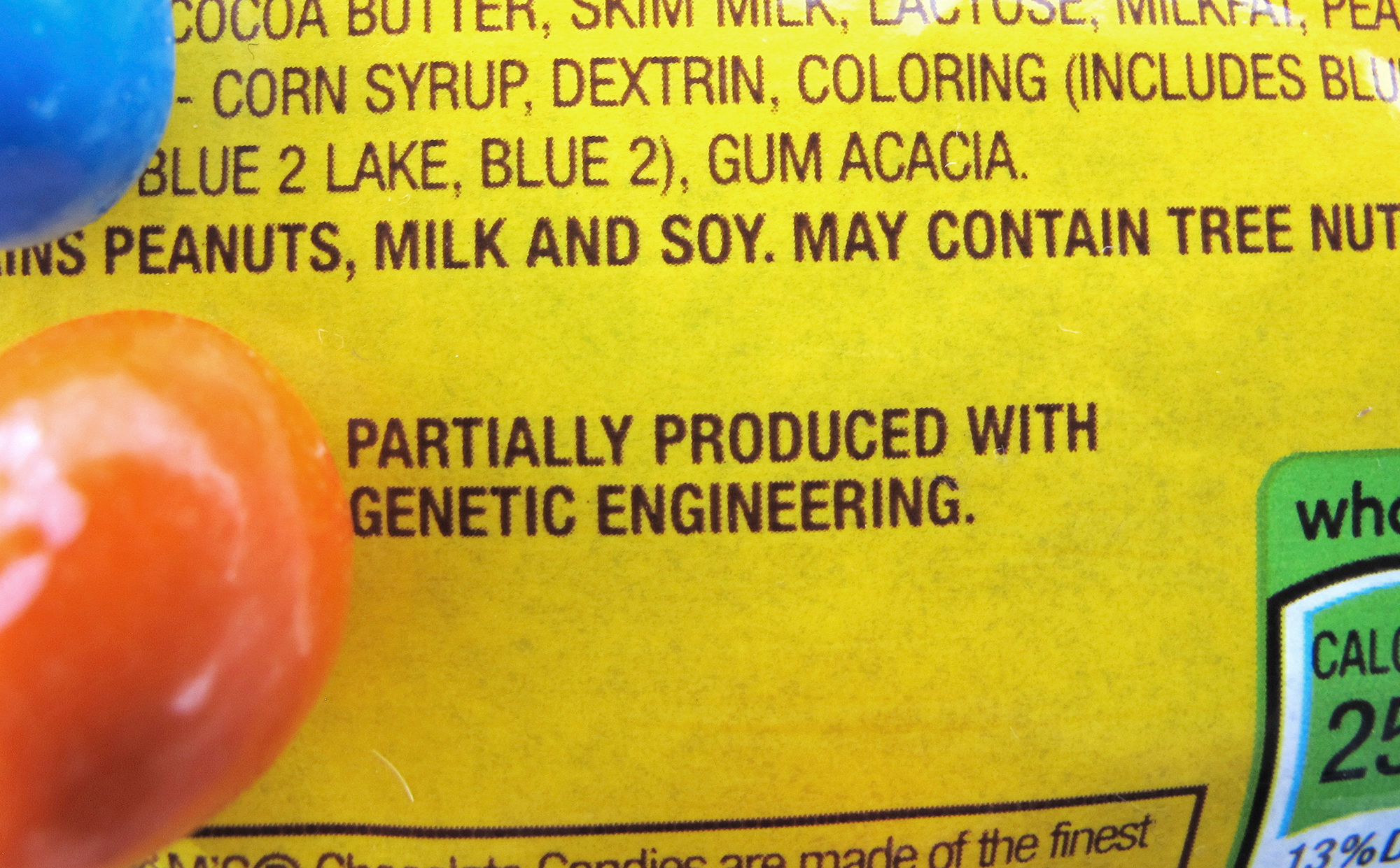 """A new disclosure statement on a package of peanut M&Ms candy notes they are """"partially produced with genetic engineering."""" (Photo by Lisa Rathke/AP)"""